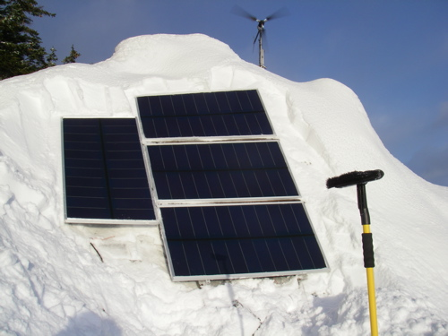 solar panels dug out of the snow
