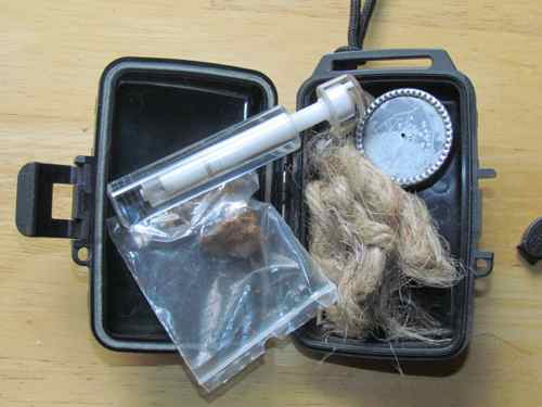My fire piston kit with chaga, tinder, and cleaning tool (Photo: Mark A. Zeiger).