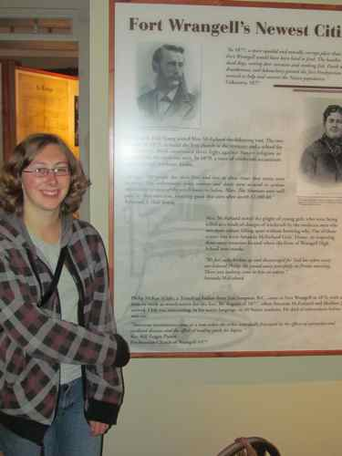 Aly next to museum placard with quote from her grandfather, Rev. Bill Zeiger (Photo: Mark A. Zeiger).
