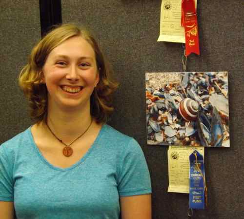 Aly and her prize winning photo (Photo: Mark A. Zeiger).
