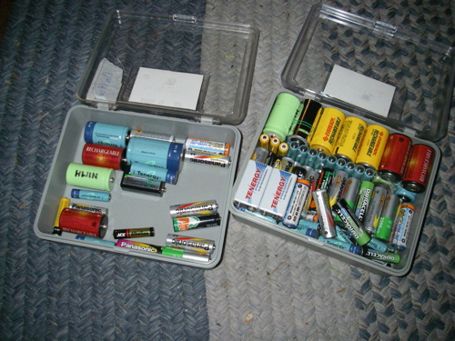 Some of our rechargeable stash, one box for charged, one for to be charged (Photo: Mark A. Zeiger).