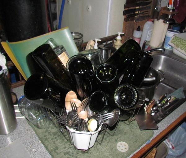 dish drainer full of bottles