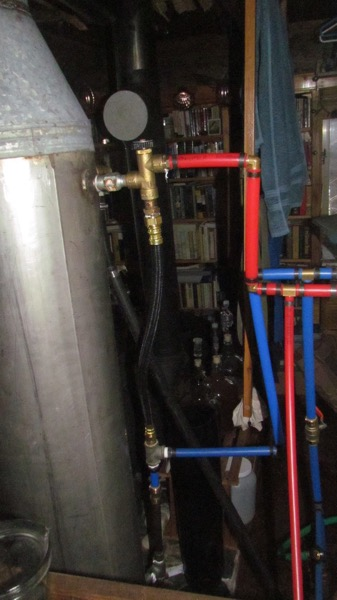 Wood-fired hot water heater plumbing